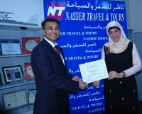 "Ms.Raihana Presenting ""Certificate of Appreciation"" to Mr.Nilesh-Sabre Travel Network"