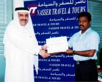 "Mr.Nasser  Presenting ""Certificate of Appreciation"" to Mr.Madhumohan"