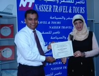 Ms.Raihana,Travel Manager,Nasser Travel and Tours,Presenting Certificate of Appreciation to Mr.Ambrose,Business Development Manager,Explore Bahrain